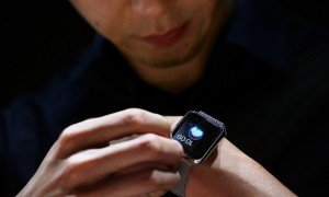 apple watch prototype at the hand of a man with dark background