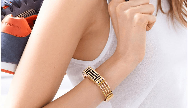 Tory Burch worked with FitBit to develop four accessories that house the Fitbit's core, which pops out of the wristband.