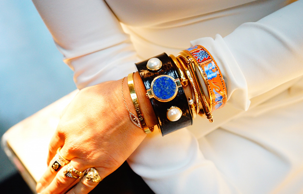 Intel Fashion Innovation - Intel MICA smart bracelet worn on the wrist by a woman in white dress, future fashion