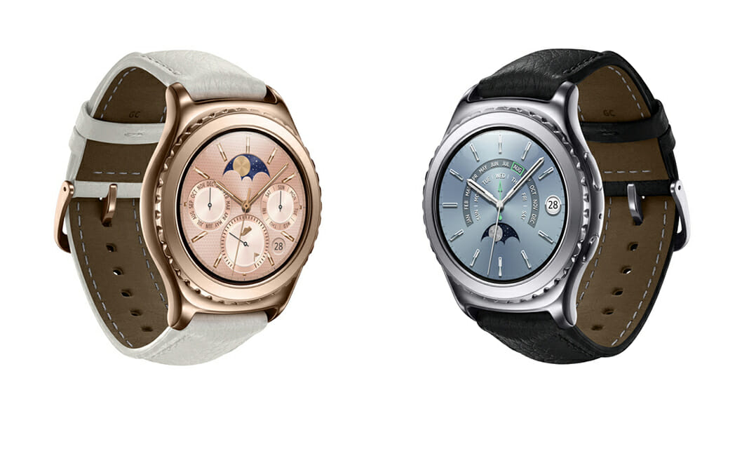 Samsung Gear S2 gold next to a Gear S2 platinum edition