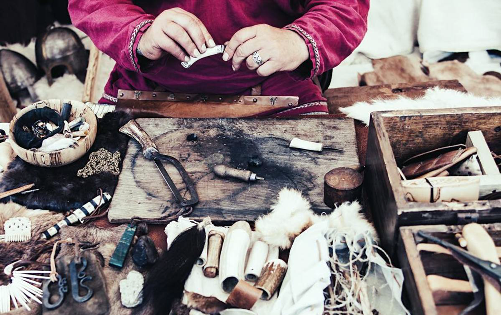 A luxury craftsman (artisan) with the tools of the trade on the table