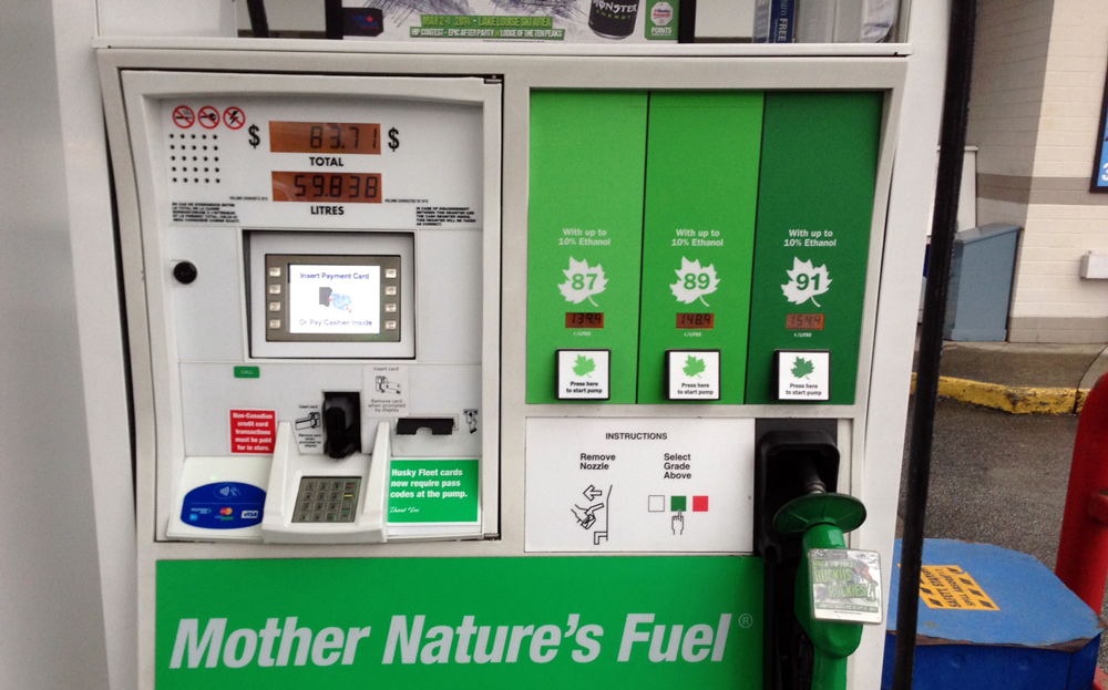A fuel pump painted in green advertising fuel as natural and healthy.