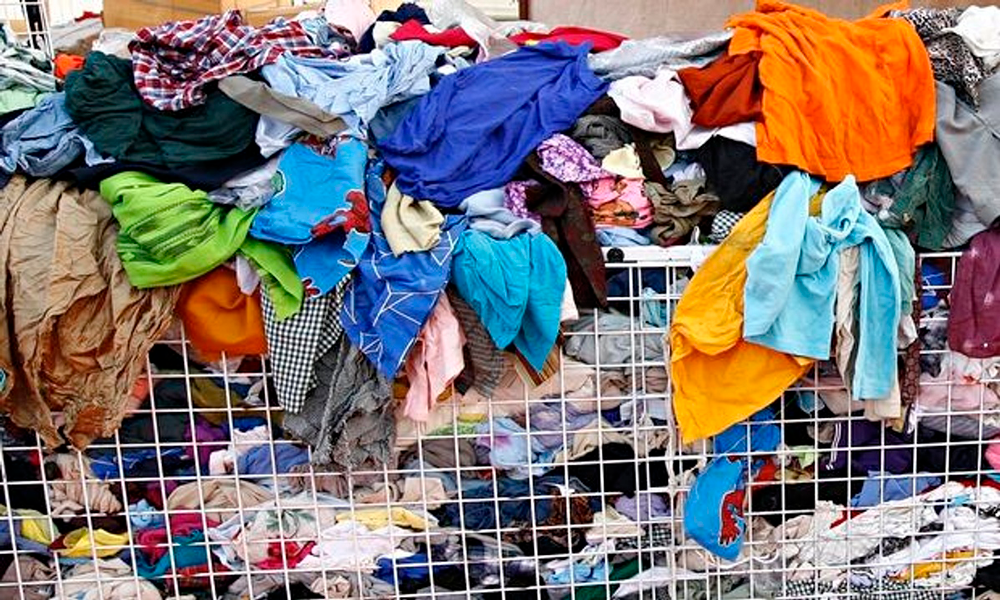 Sustainable Fashion Influencers - pile of wasted clothes