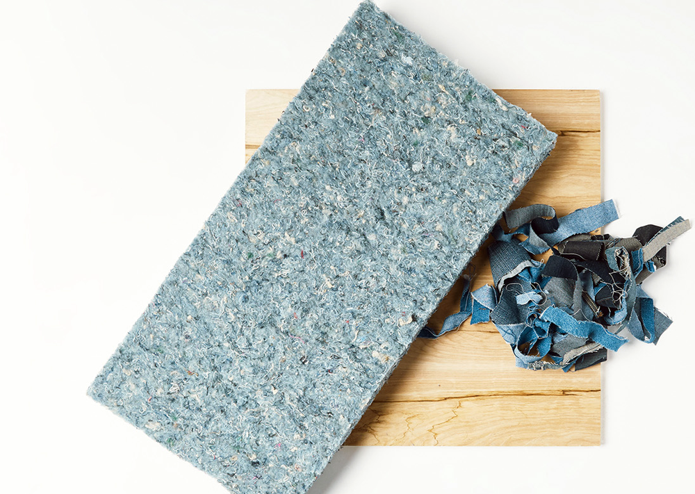 Innovative Recycling - a block of recycled fabrics next to cut up pieces of blue jeans