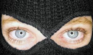 ethical consumer - hidden face by ski mask