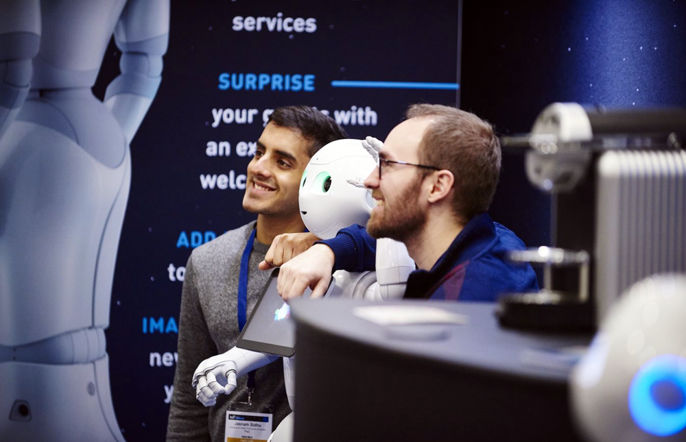 AI Expo Global 2018 two experts checking out an AI robot