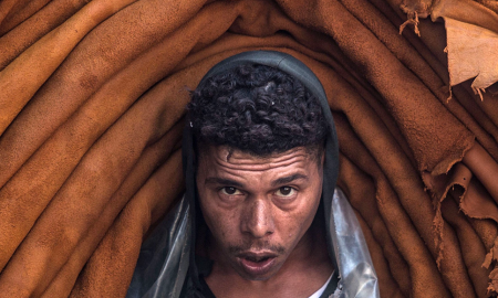 sustainable-leather-alternatives--worker-in-tunisia-carryign-a-large-load-of-animal-skins