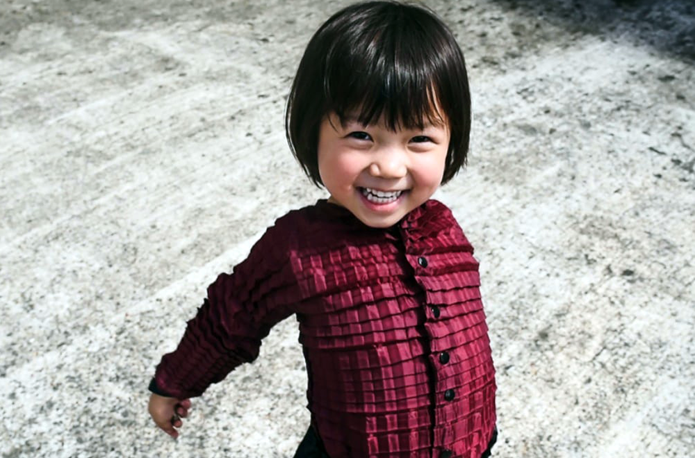 Growing Clothes asian-child-girl-wearing-a-plated-purple-shirt