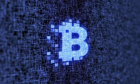 Luxury Brands On The Blockchain - bitcoin logo in blue
