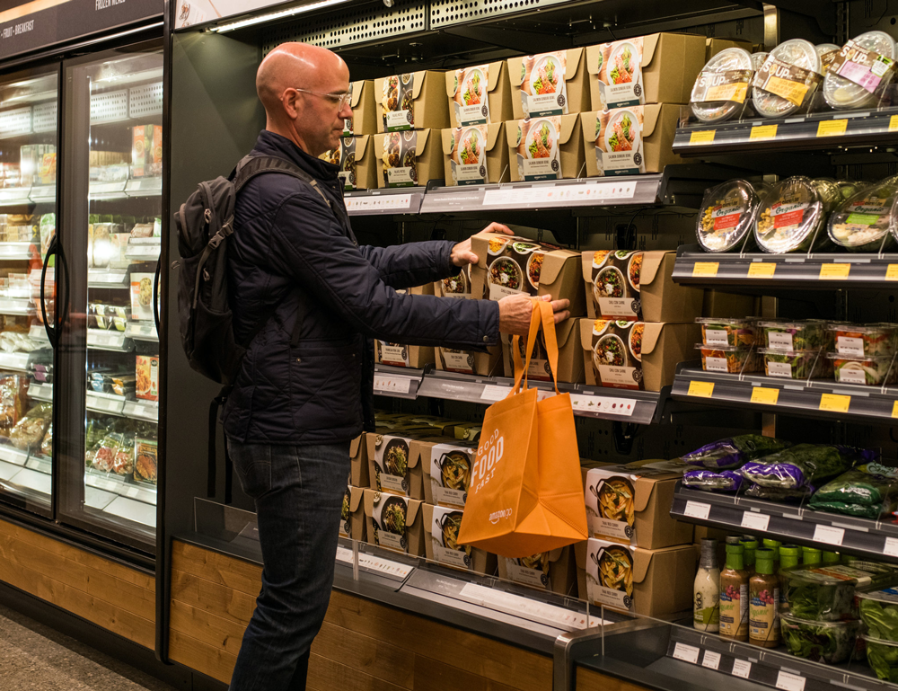 amazon-go-man-taking-food-from-the-shelve