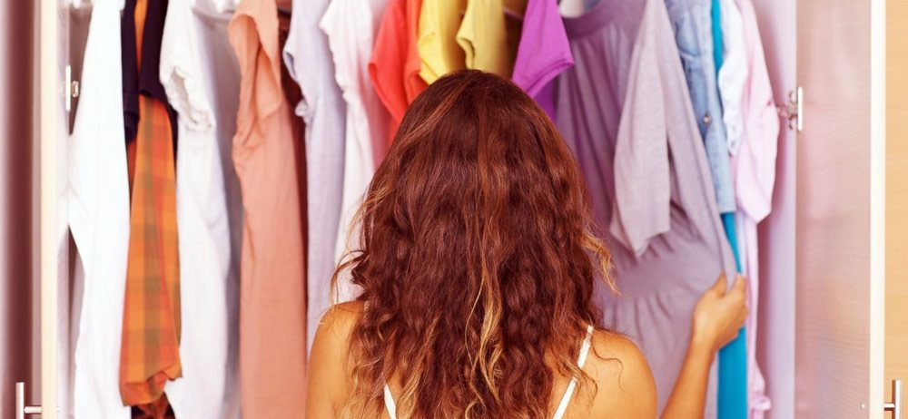 Collaborative Consumption In Fashion - girl looking at her sustainable wardrobe - WTVOX Research Impact