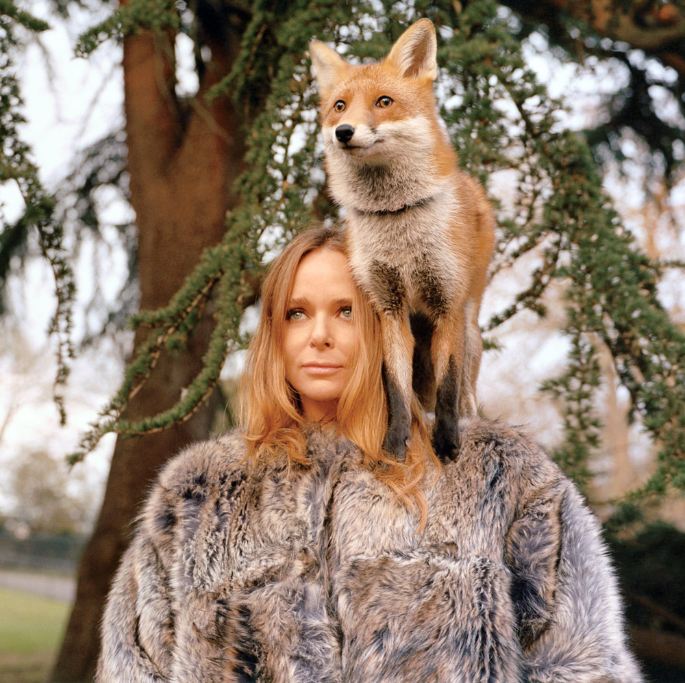 Vegan Fashion - WTVOX Research Impact - Stella MacCartney standing with vegan fur coat with a fox sitting on her shoulder