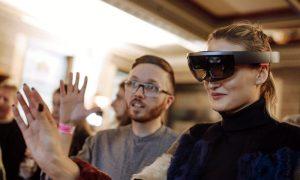 Fashion Innovation News - London College of Fashion female student using a Microsoft HoloLens AR Headset