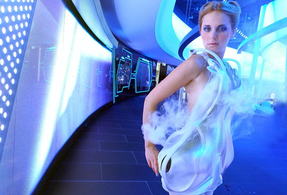 Fashion Biomimicry - futuristic neon dress in a space ship