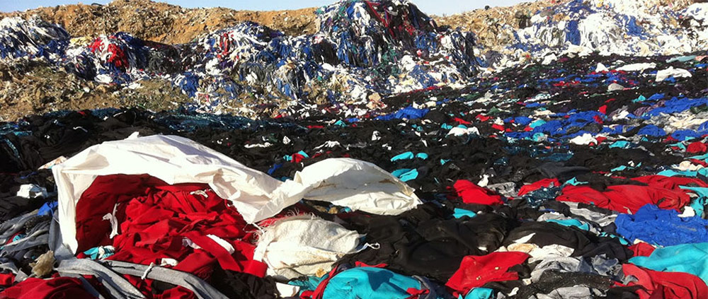 Textile Innovation Empowering Sustainable Fashion - Possible Solutions - textile waste is piled up in the environment