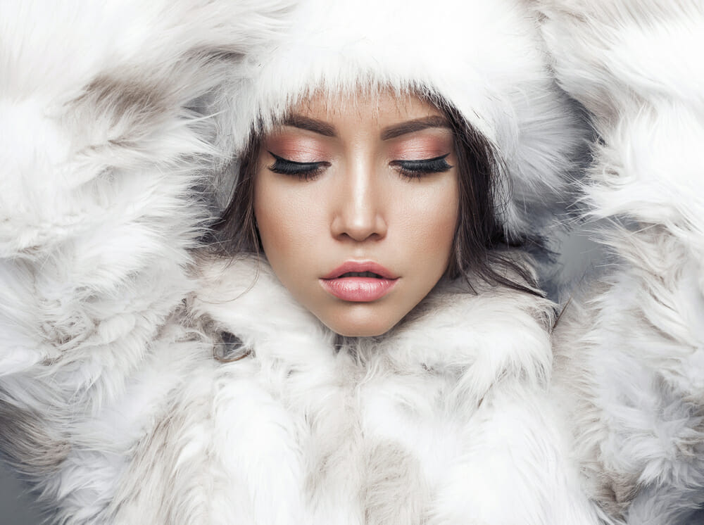 Vegan Fashion - WTVOX Research Impact - girl covered in white feathers