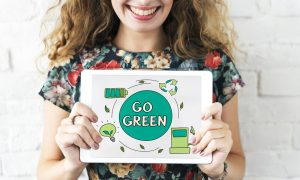 Sustainable Fashion Influencers - girl holding an eco-fashion banner