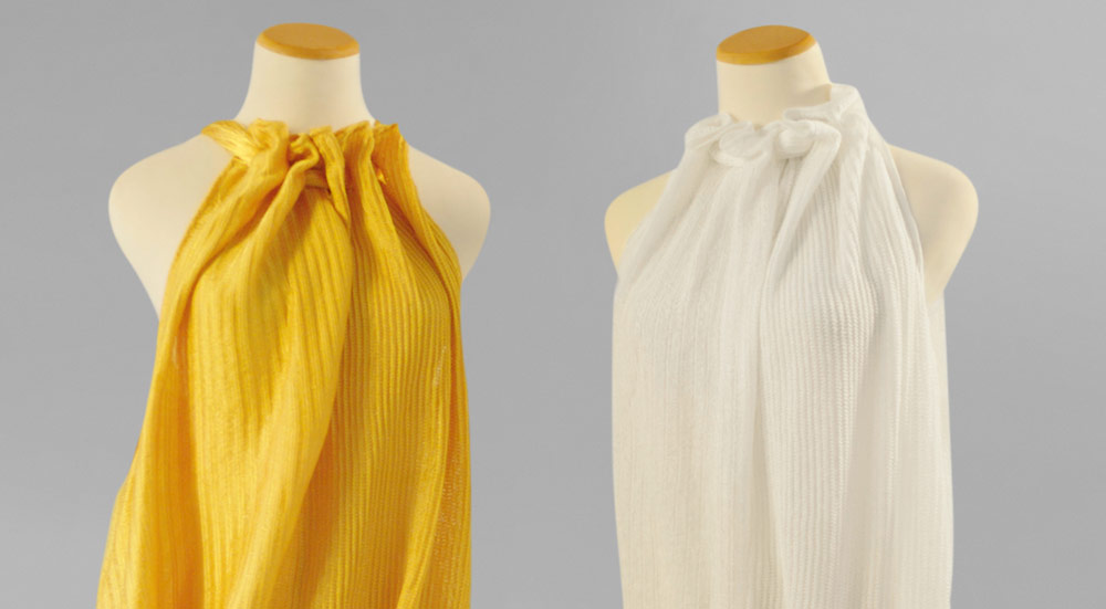The Path Towards Sustainable Fashion - About Bolt Threads - Stella mccartney microsilk yellow and white dresses