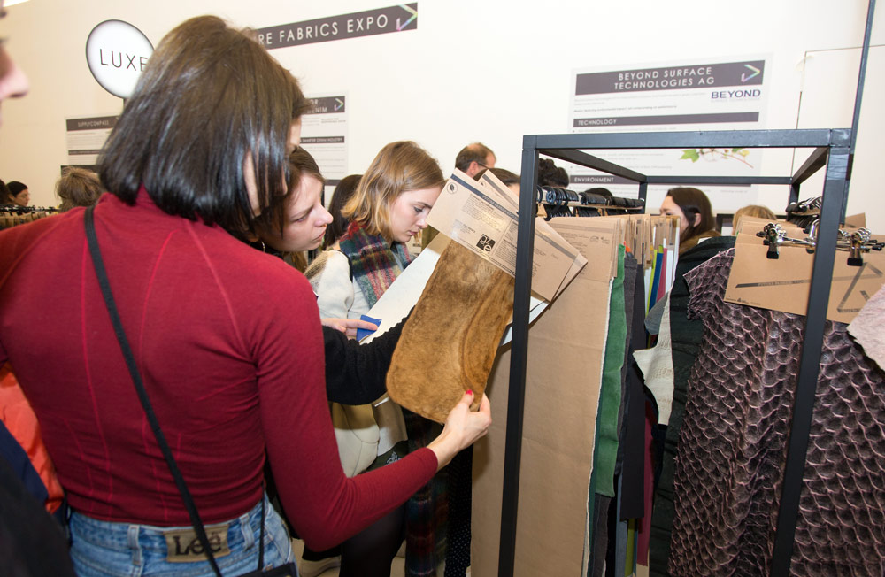 Fashion Innovation Alters Leather Production And Consumption - The Role Of Consumers - a woman in a red top is looking at eco-friendly faux-leather material