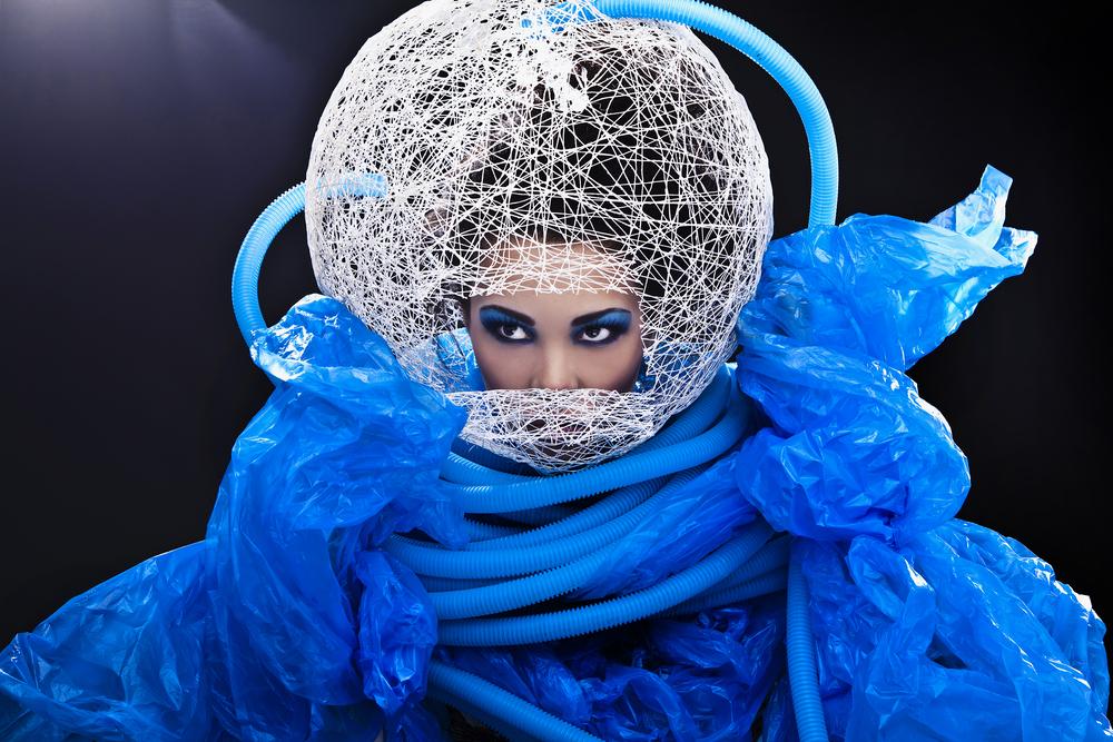 FashionTech - futuristic fashion woman wearing a blue dress