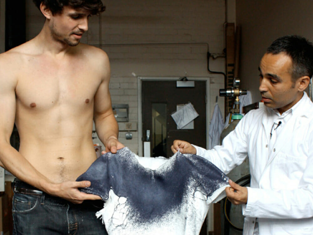 Fabrican Sprayable Clothes - Two men looking at a sustainable tshirt
