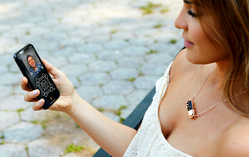 Smart Jewelry - Young girl using Talsam Smart Jewelry to get connected to her partner