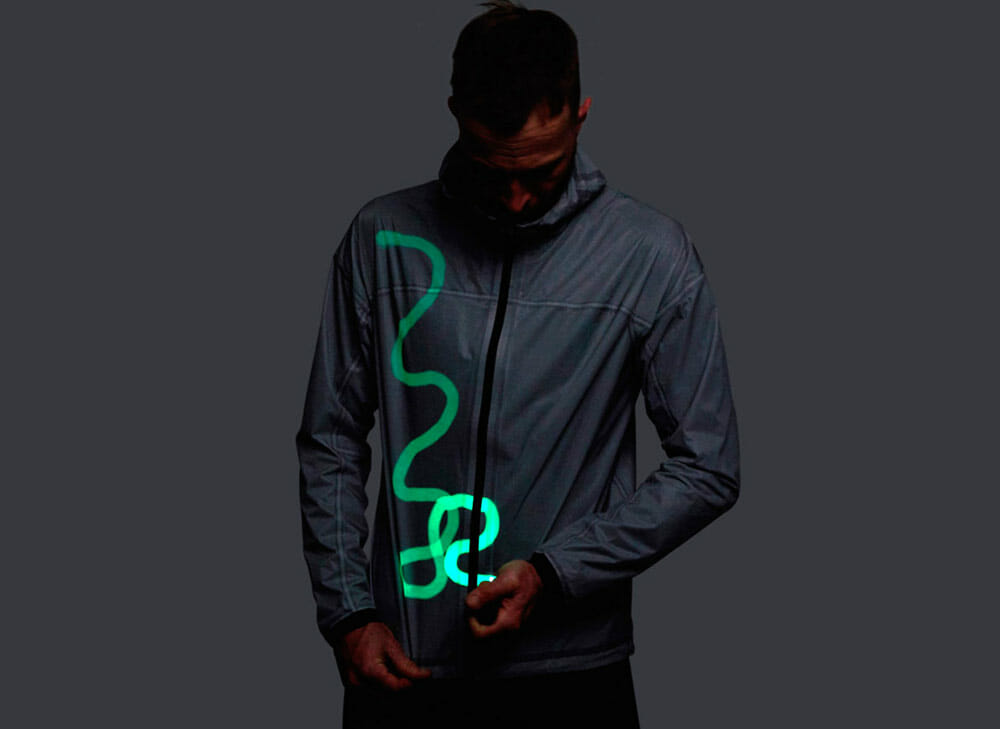 Top 5 Fashion Tech Outdoor Clothing - drawing on Vollebak Solar Charged Jacket in the dark