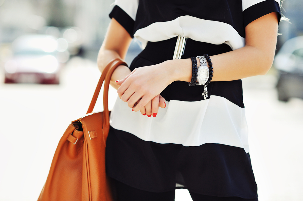 best date night smartwatch - woman casually dressed with stripes dress