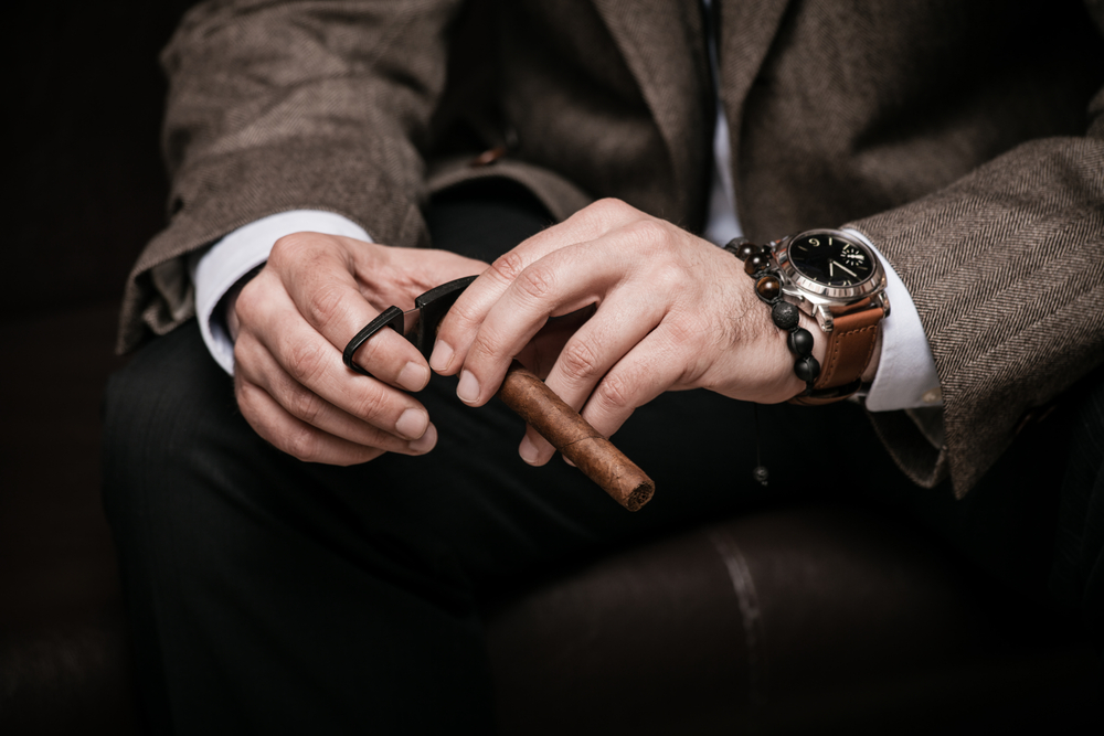 best date night smartwatch - brown suit for men with a cigar and a brown leather smartwatch