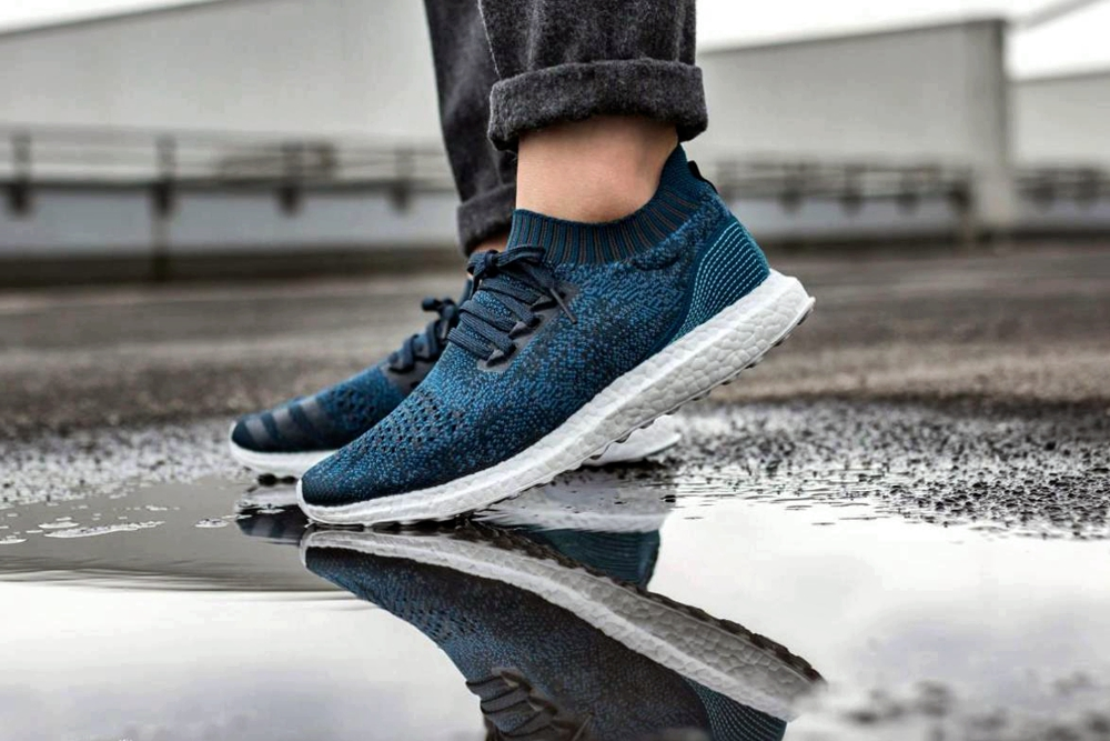 Advances In The Fashion Industry and sustainable clothing - blue adidas parley with jeans