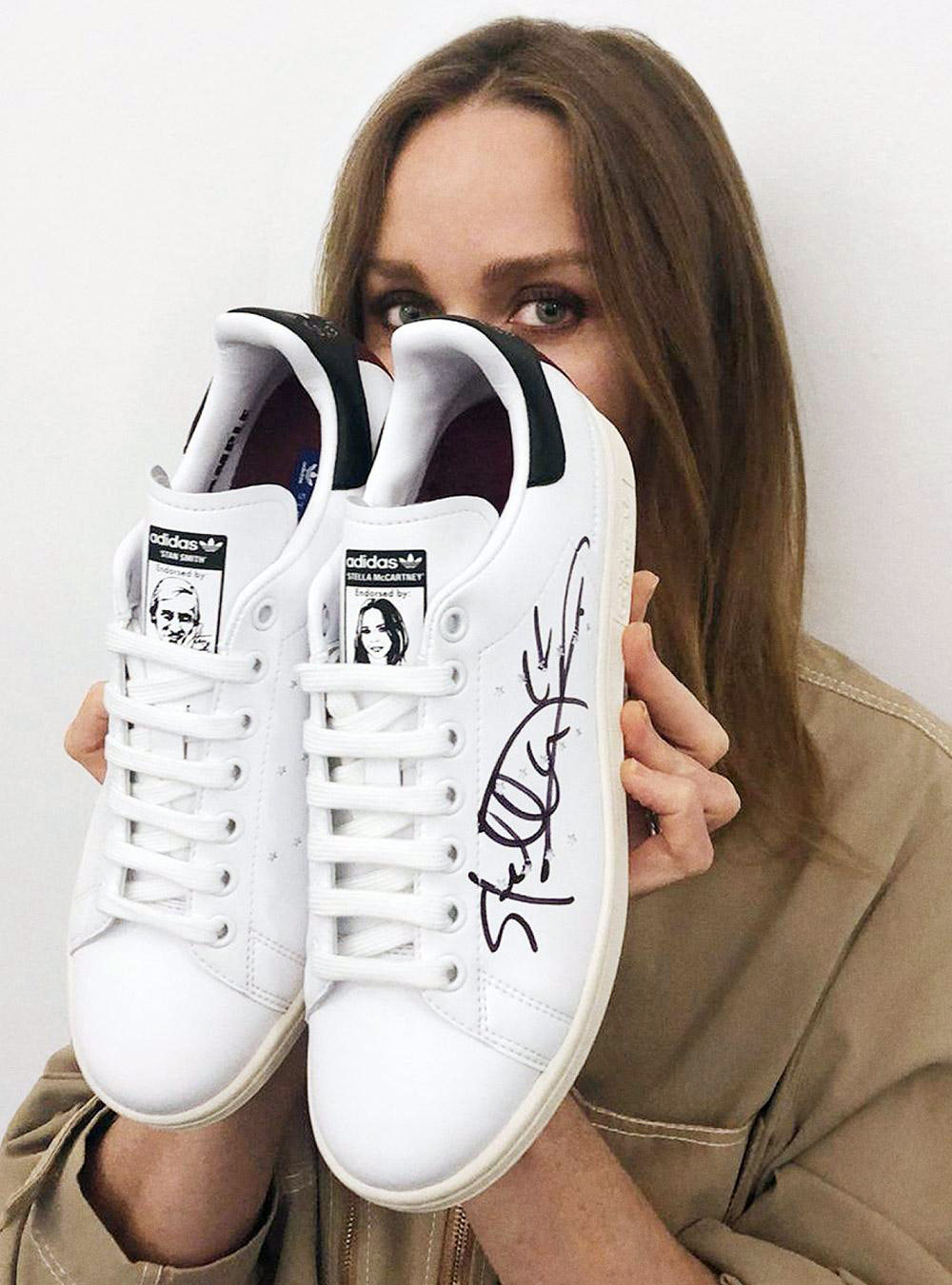 Vegan Adidas Stan Smith trainers by Stella McCartney - Stella holding the vegan trainers