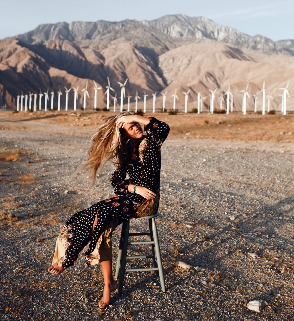 Changing The Face Of Sustainable Fashion - girl wearing beautiful dress in a wind power field