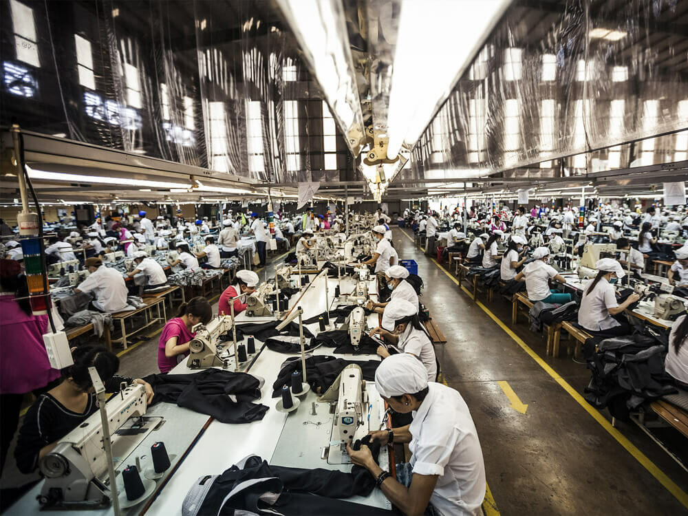 Clothing factory with women working in fashion industry