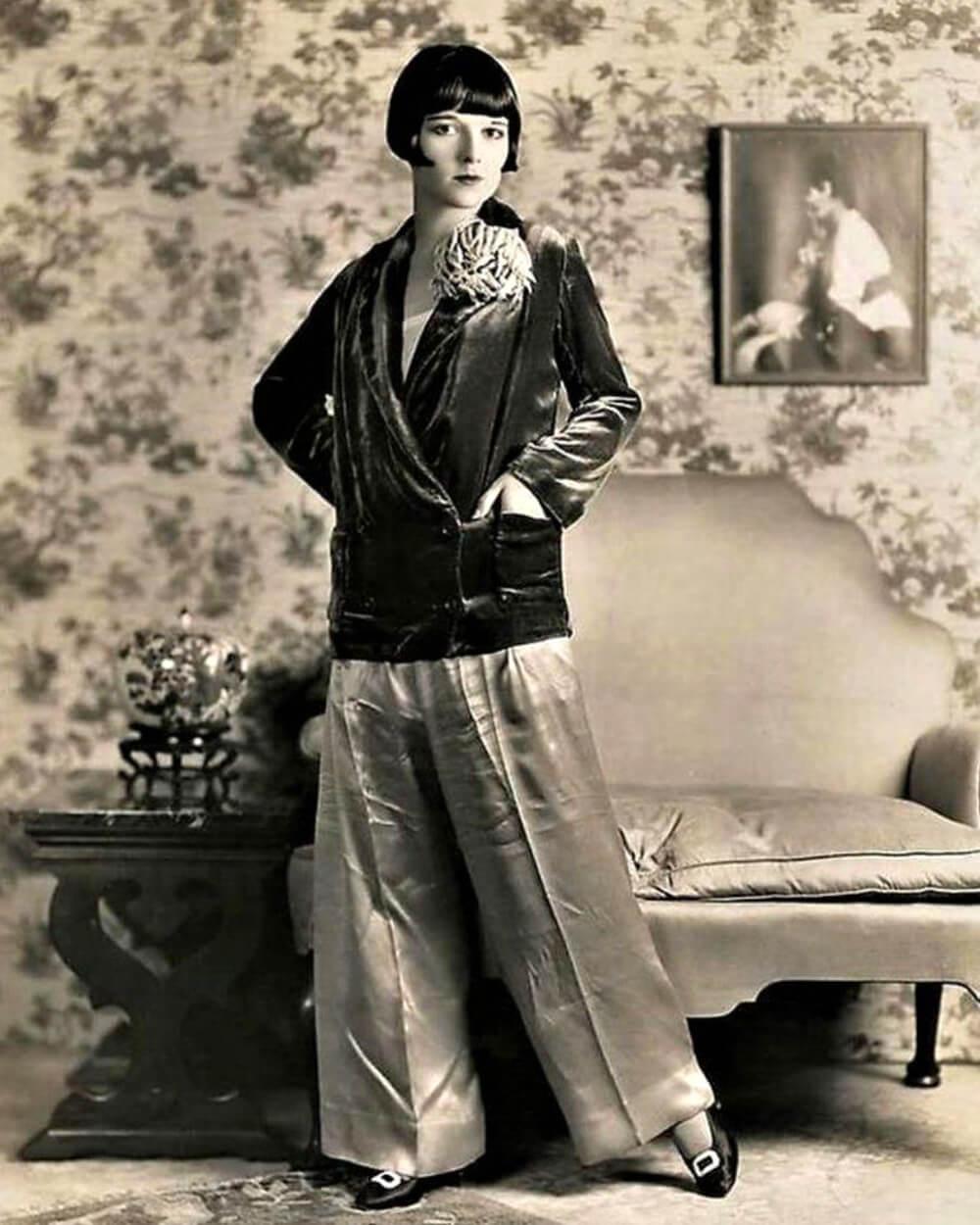 Flapper style of 1900s women wearing trousers