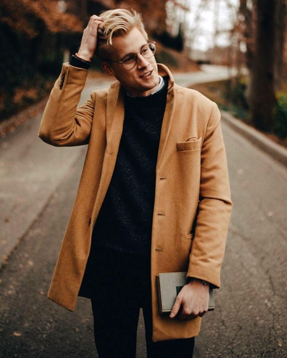 Dark tweed sweater with a light brown jacket