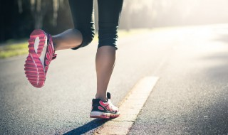 A woman running while wearing a fitness tracker - wearables -wt vox